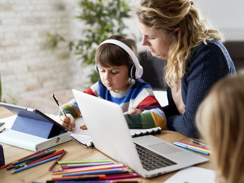 Adobe Stock 419104090 Mum Helping Children Home Learn Copy