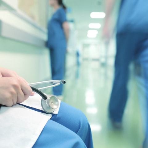 medical practitioners in a hospital hallway