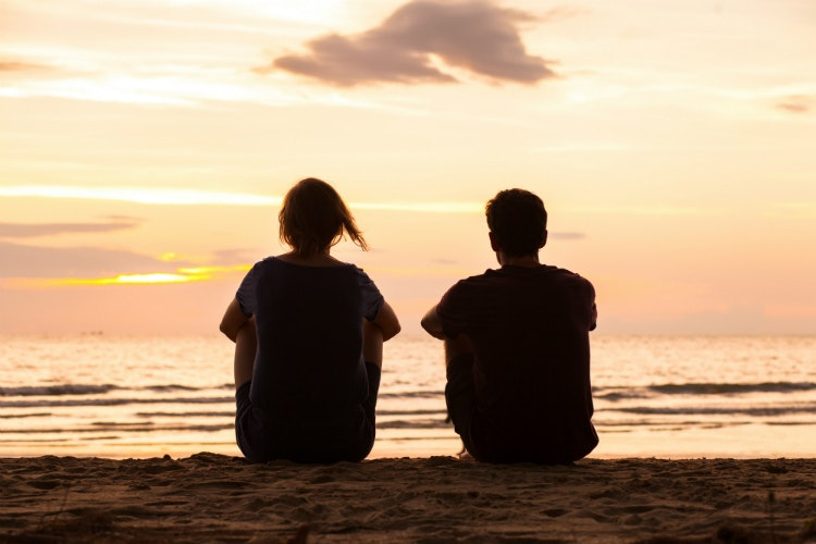 two people at sunset on the beach